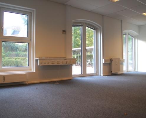 Et af vores kontorer i Stueetagen, hvor du kan gå direkte ud i vores hyggelige baggård.